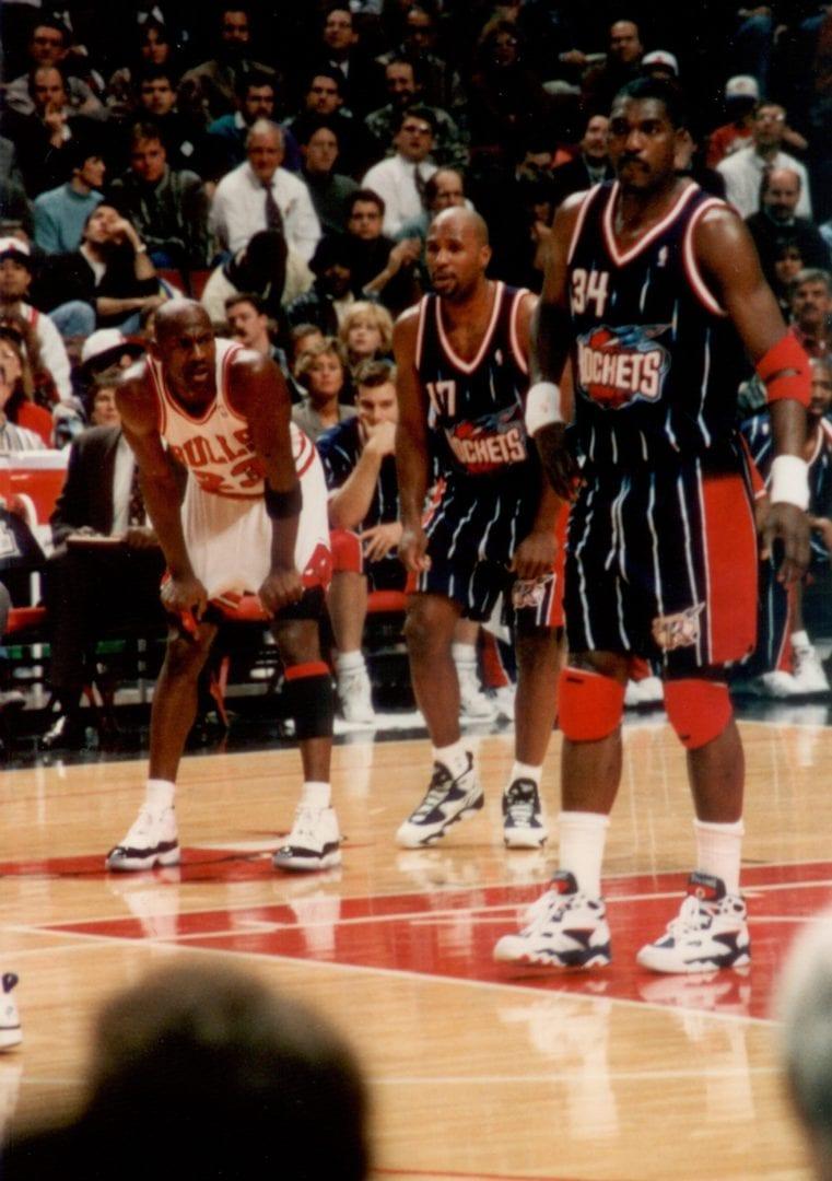 Three basketball players