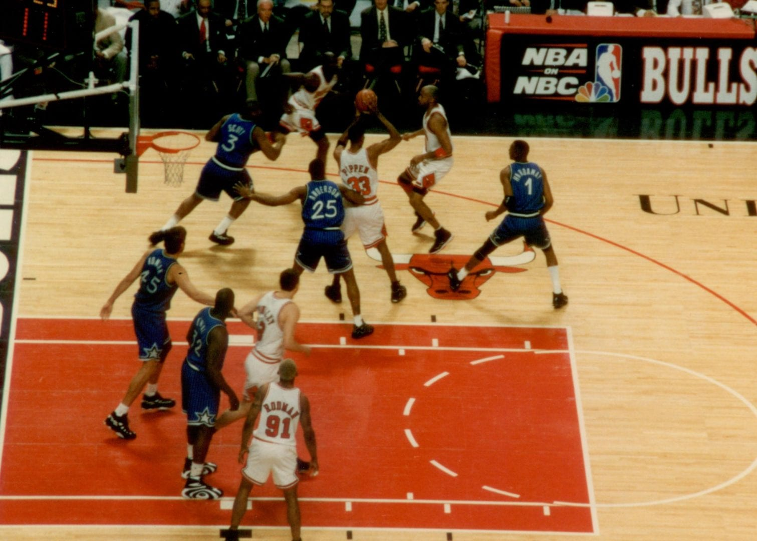 Players in blue doing a defense
